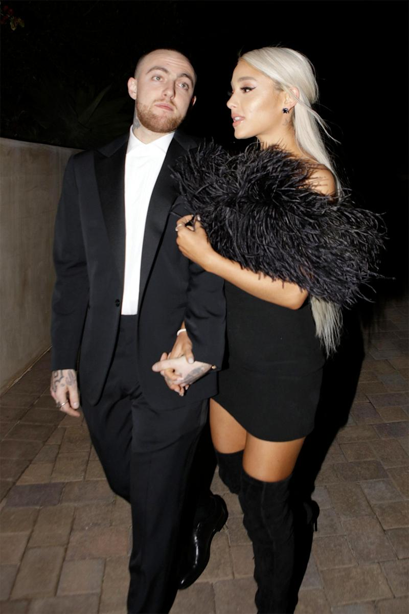 Mac Miller and singer Ariana Grande are seen attending an Oscar party.