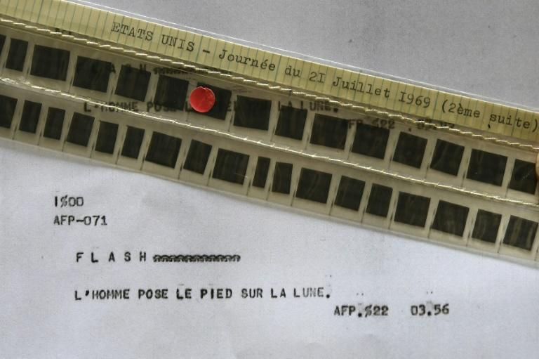 This 2019 photograph shows the AFP flash, stored in the agency's microfilmed archives, that announced that man had stepped on the Moon for the first time in July 1969 (AFP Photo/Anne-Christine POUJOULAT)
