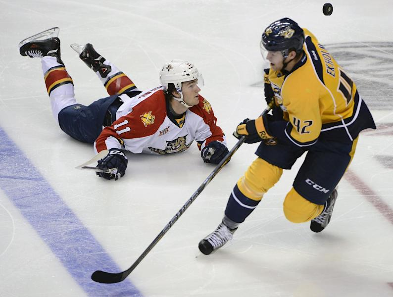 Florida Panthers center Jonathan Huberdeau (11) falls to the ice after Nashville Predators defenseman Jonathan Huberdeau, of Sweden, knocked the puck away in the second period of an NHL hockey game on Tuesday, Oct. 15, 2013, in Nashville, Tenn. (AP Photo/Mark Zaleski)