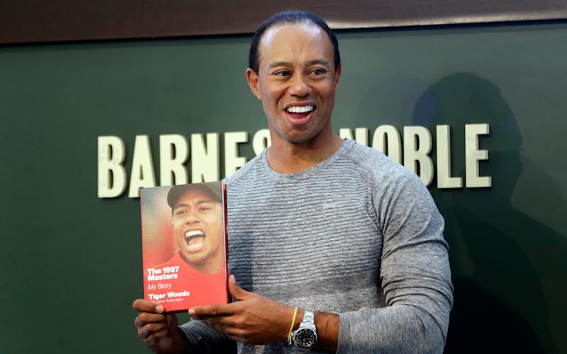 Tiger Woods's hair was noticeably thinner as he promoted his new book in New York - Copyright 2017 The Associated Press. All rights reserved.