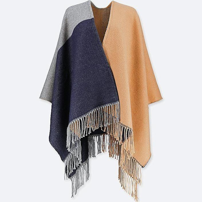 "Versatility reigns supreme for travelers. This stole can also be used as a chunky scarf or even a wrap or blanket. <strong><a href=""https://www.uniqlo.com/us/en/women-windowpane-2-way-stole-408917COL30SIZ999000.html"" rel=""nofollow noopener"" target=""_blank"" data-ylk=""slk:Get it here"" class=""link rapid-noclick-resp"">Get it here</a></strong>."