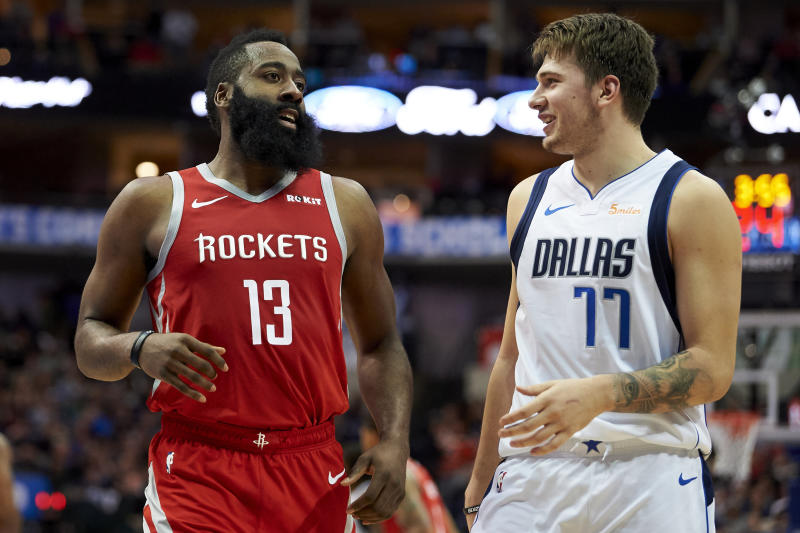 Houston Rockets guard James Harden (13) and Dallas Mavericks forward Luka Doncic (77) talk during the second half of an NBA basketball game, Saturday, Dec. 8, 2018, in Dallas. (AP Photo/Cooper Neill)