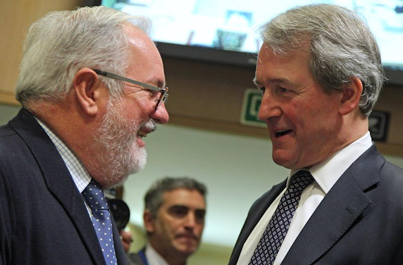 Spain's agriculture minister Miguel Arias Canete, left, talks with British Secretary of State for the Environment, Food, & Rural Affairs Owen William Paterson, during the EU agriculture ministers council at the European Council building in Brussels, Monday, Feb. 25, 2013. The European Union's agriculture ministers gathered in Brussels Monday to discuss the widening scandal's fallout, with some member states pressing for tougher rules to regain consumer confidence. (AP Photo/Yves Logghe)