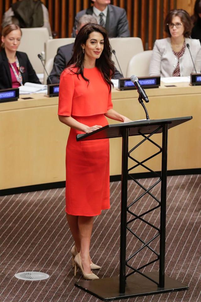 <p>Amal wore a simple orange dress paired with tan heels while speaking at the <em>Press Behind Bars: Undermining Justice and Democrac</em>y event at the United Nations in New York.</p>