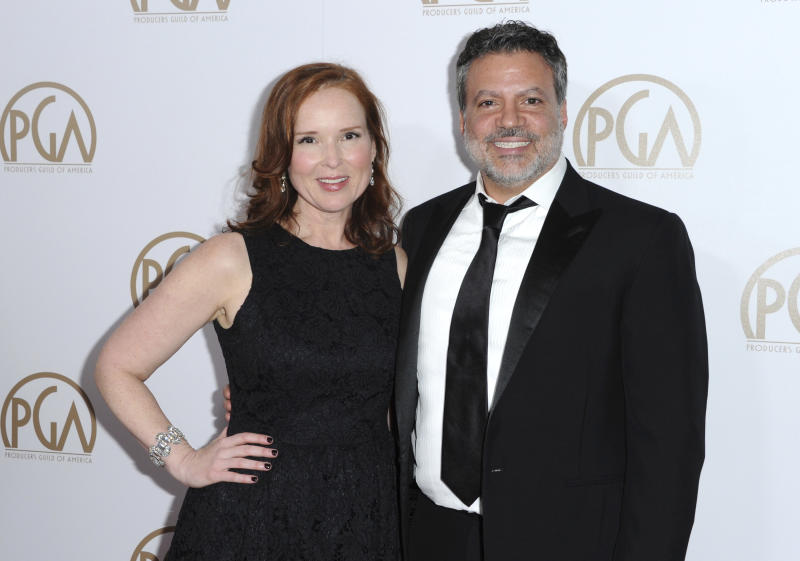 FILE - This Jan. 23, 2016 file photo shows Oscars producers Jennifer Todd, left, and Michael De Luca at the 27th Annual Producers Guild Awards in Los Angeles. Although the first-time Oscar telecast producers may want their show to focus on the magic of the movies, they say they support any message spoken from the heart, even if it means turning the Oscar podium into a political pulpit. (Photo by Richard Shotwell/Invision/AP, File)