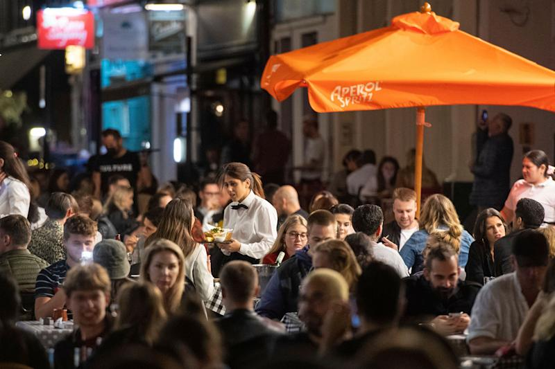 People sit outdoors during a night out in Soho in London's West End on Saturday, September 12 2020. (Photo: ASSOCIATED PRESS)