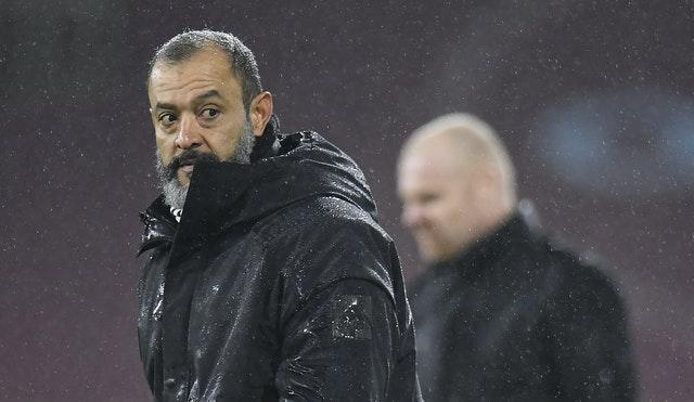 Wolves manager Nuno Espirito Santo, left, watches on