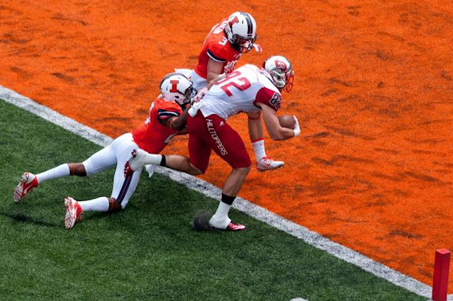 Western Kentucky Hilltoppers tight end Tyler Higbee (82) crosses the goal line as Illinois Fighting Illini defensive back Eaton Spence (27) and Illinois defensive back Taylor Barton (3) try to tackle during the second quarter of an NCAA college football game, Saturday, Sep. 6, 2014, at Memorial Stadium in Champaign, Ill. (AP Photo/Bradley Leeb)
