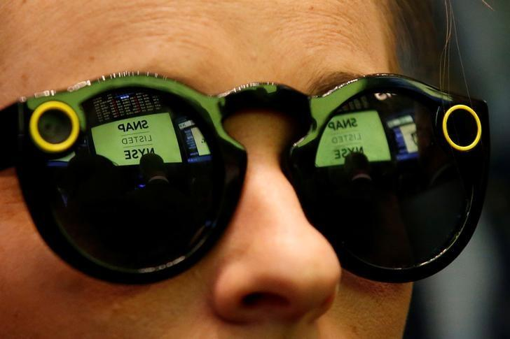 A woman wears Snapchat Spectacles on the floor of the NYSE while waiting for Snap Inc. to list their IPO in New York