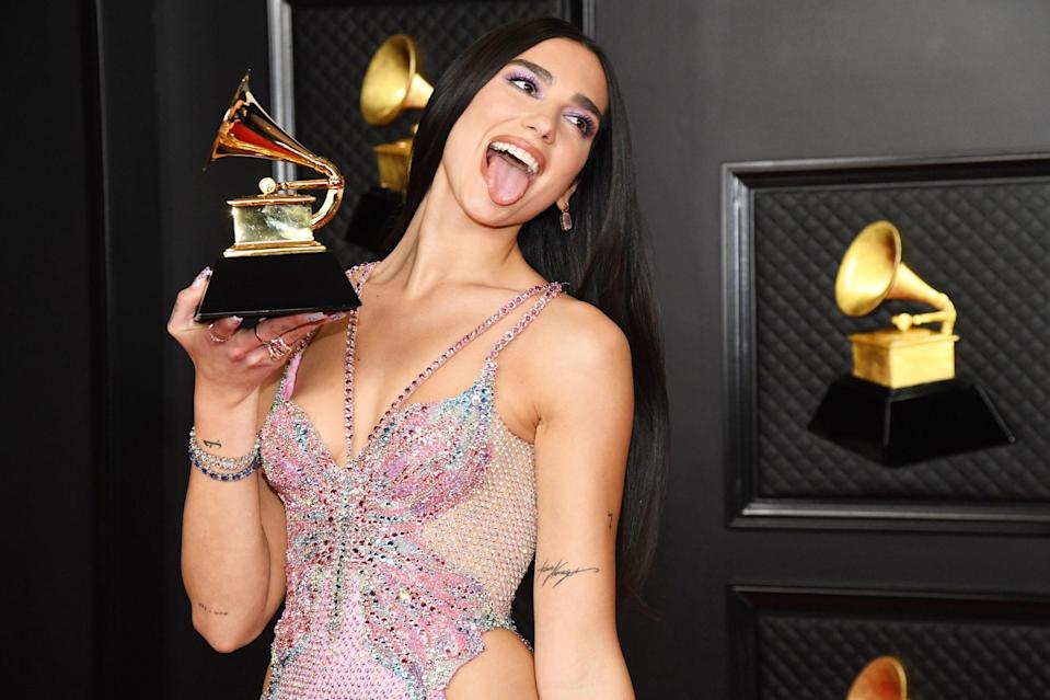 <p>Newly minted Grammy winner Dua Lipa celebrates her best pop vocal album win on Sunday night with a photo shoot at the awards ceremony in L.A. </p>