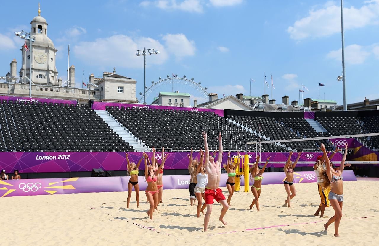 LONDON, ENGLAND - JULY 25:  Dancers rehearse at the Beach Volleyball venue at Horse Guards Parade on July 25, 2012 in London, England.  (Photo by Ryan Pierse/Getty Images)