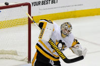 Pittsburgh Penguins goaltender Tristan Jarry (35) deflects the puck during the third period of an NHL hockey game against the New Jersey Devils, Sunday, April 11, 2021, in Newark, N.J. (AP Photo/Kathy Willens)