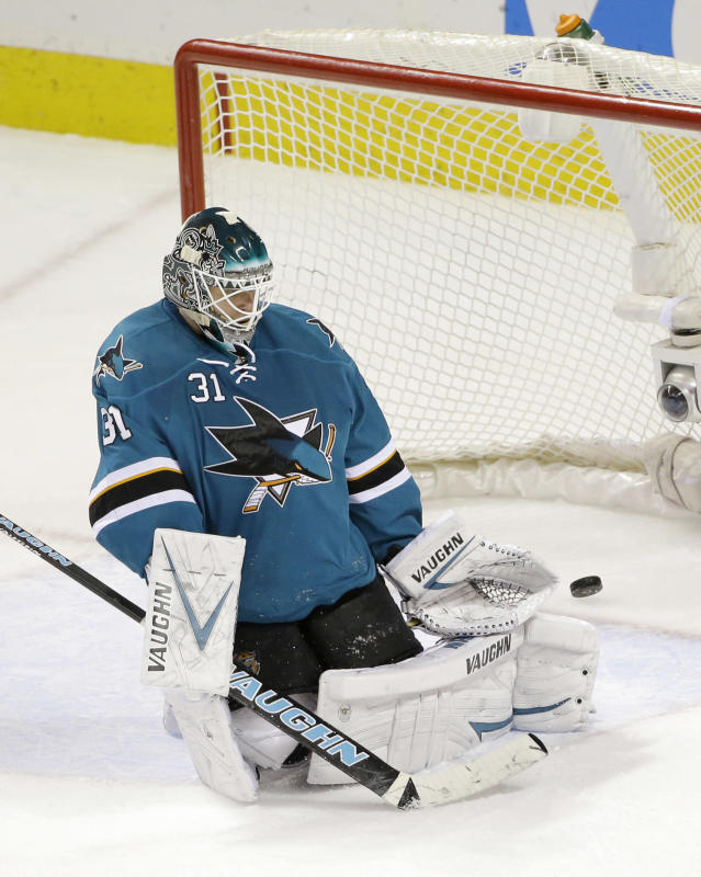 San Jose Sharks goalie Antti Niemi (31), of Finland, is beaten for a goal on a shot from Florida Panthers' Scottie Upshall during the second period of an NHL hockey game on Tuesday, March 18, 2014, in San Jose, Calif. (AP Photo/Marcio Jose Sanchez)