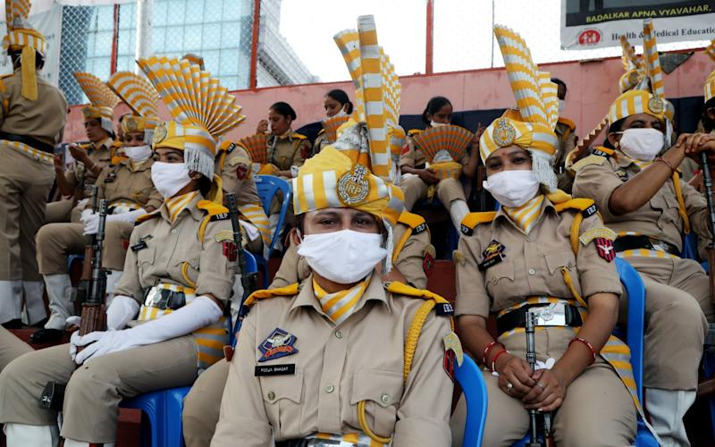 Cadets of India's armed forces wear face masks during a full and final dress rehearsal for an Independence Day parade in Jammu, India, 13 August 2020 - Shutterstock