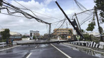 Electrical poles are toppled due to strong winds from Typhoon Goni in Daet, Camarines Norte province, central Philippines, Sunday Nov. 1, 2020. The super typhoon slammed into the eastern Philippines with ferocious winds early Sunday and about a million people have been evacuated in its projected path, including in the capital where the main international airport was ordered closed. (AP Photo/Sharalaine Robles Gonzales)