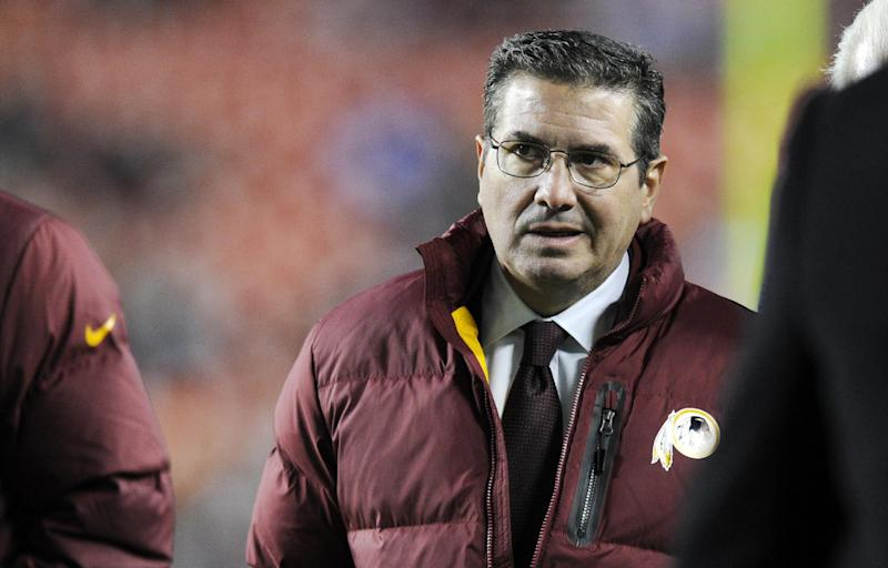 """In this Dec. 1, 2013, file photo, Washington Redskins owner Dan Snyder walks off the field before an NFL football game against the New York Giants in Landover, Md. Washington Redskins owner Dan Snyder said Tuesday, April 22, 2014, it's time for people to """"focus on reality"""" concerning Native American matters instead of criticizing the team's nickname. Challenged by those who consider the name """"Redskins"""" offensive, Snyder and his staff recently traveled to Native American reservations and last month established a foundation to assist American Indian tribes"""