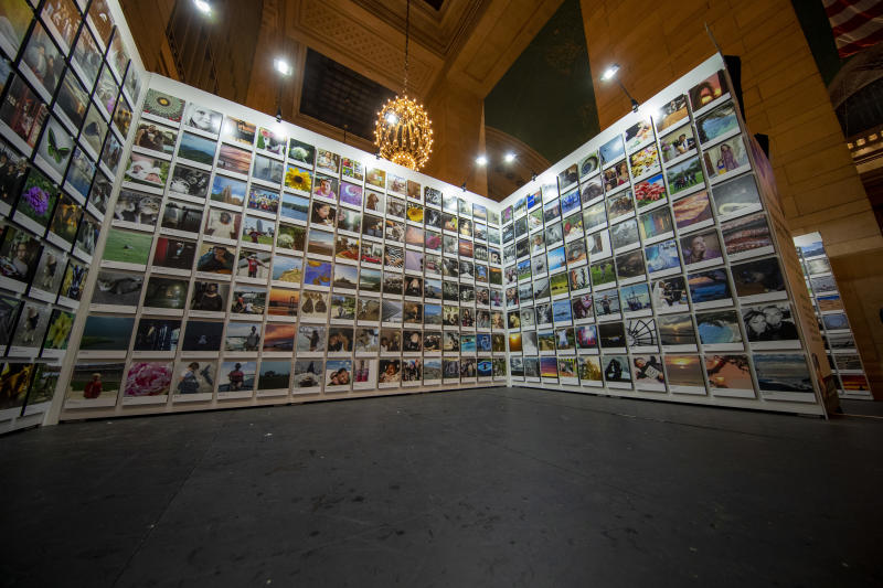 A special section of the exhibit is dedicated to showcasing images from 100cameras, a nonprofit organization that works globally with children who have had challenging experiences. (Photo: Gordon Donovan/Yahoo News)