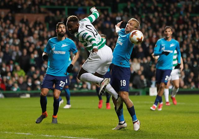 Soccer Football - Europa League Round of 32 First Leg - Celtic vs Zenit Saint Petersburg - Celtic Park, Glasgow, Britain - February 15, 2018 Celtic's Moussa Dembele in action with Zenit St. Petersburg's Igor Smolnikov REUTERS/Russell Cheyne