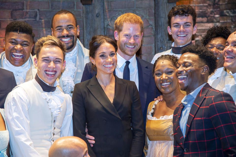 """The Duke and Duchess of Sussex with the cast of """"Hamilton."""" Image via Getty Images."""