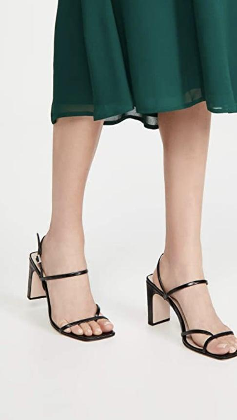 <p>The height and heel shape of these <span>Schutz Amaia High Block Sandals</span> ($47) sold us.</p>