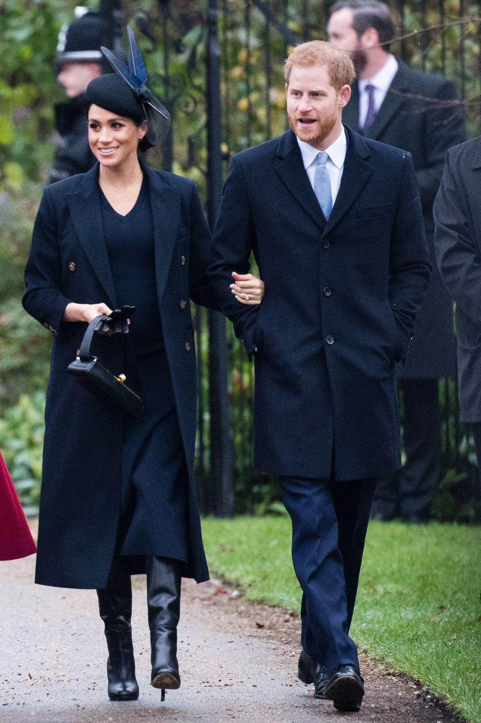 <p>Prince Harry walks arm in arm with Meghan Markle as they make their way into Christmas Day church services. </p>