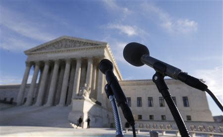 Microphones are set up for attorneys in front of the U.S. Supreme Court for them to talk after delivering oral arguments in a U.S. President Barack Obama recess appointments