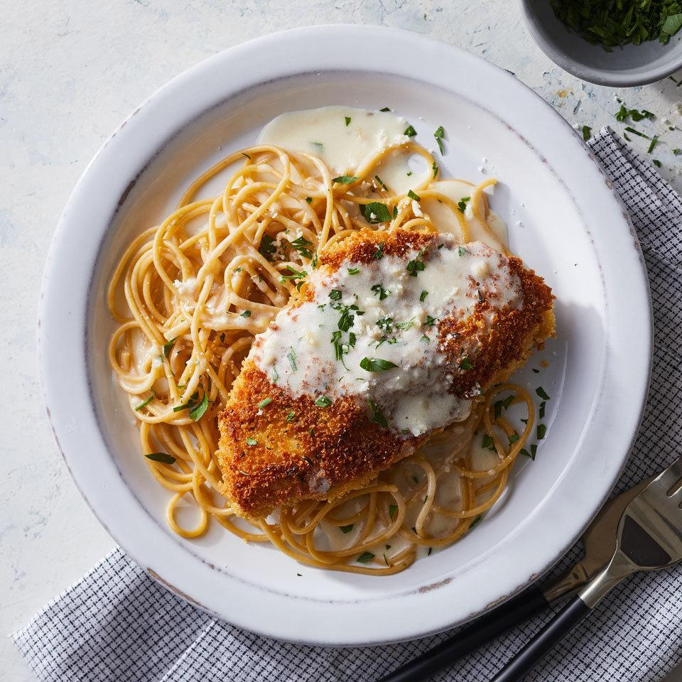 <p>This riff on classic chicken Parmesan replaces the usual marinara with a luscious lemony cream sauce. We've lightened it up by using half-and-half instead of cream, with just-as-delicious results. Serve this lemony chicken dinner with whole-wheat pasta or brown rice.</p>