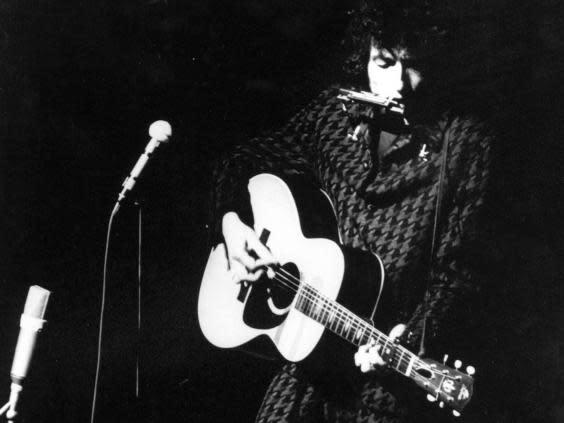 Dylan performs at a Paris concert in 1966 (Rex/Shutterstock)