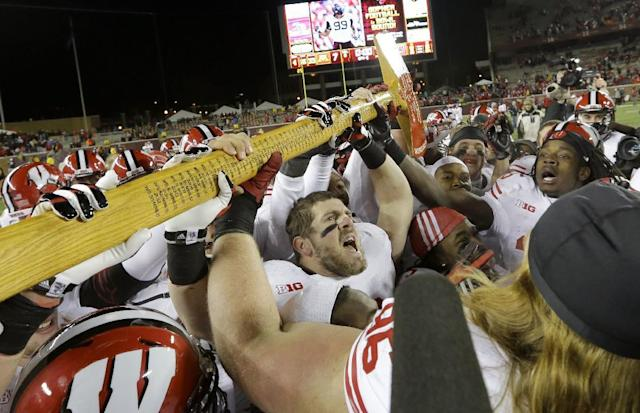 The winner of the Wisconsin-Minnesota game will also hoist Paul Bunyan's Axe. (AP)