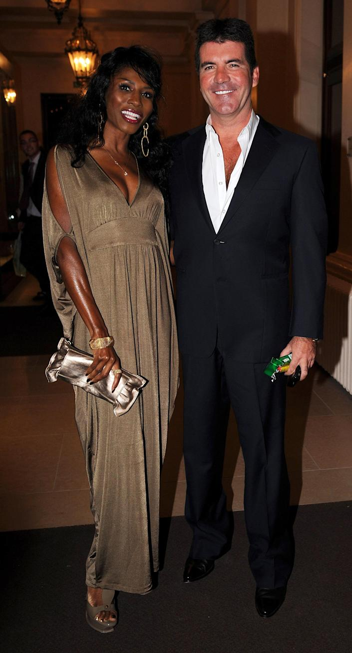 Simon Cowell arrives with Sinitta at the Royal Opera House, London for the Battersea Collars and Cuffs Ball, in aid of Battersea Dogs and Cats Home.