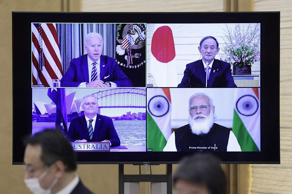 U.S. President Joe Biden, top left, Yoshihide Suga, Japan's prime minister, top right, Scott Morrison, Australia's prime minister, bottom left, and Narendra Modi, India's prime minister, on a monitor during the virtual Quadrilateral Security Dialogue (Quad) meeting at Sugas official residence in Tokyo, Japan, on Friday, March 12, 2021.