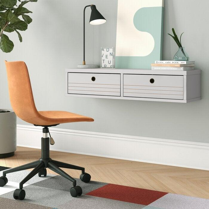 """<h3>Foundstone Hayward Floating Desk<br></h3><br>Your walls can actually be precious space-saving real estate if they're not already covered in framed photos and artwork. This floating desk is a practical way to create a new and useable workspace without taking up room on the floor.<br><br><strong>Foundstoneu2122</strong> Hayward Solid Wood Floating Desk, $, available at <a href=""""https://go.skimresources.com/?id=30283X879131&url=https%3A%2F%2Fwww.wayfair.com%2Ffurniture%2Fpdp%2Ffoundstone-hayward-solid-wood-floating-desk-w001957511.html"""" rel=""""nofollow noopener"""" target=""""_blank"""" data-ylk=""""slk:Wayfair"""" class=""""link rapid-noclick-resp"""">Wayfair</a>"""