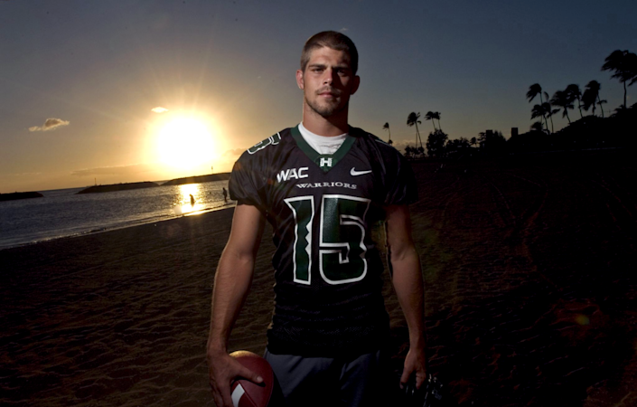 Colt Brennan poses on Waikiki Beach during his time at Hawaii in August 2007.