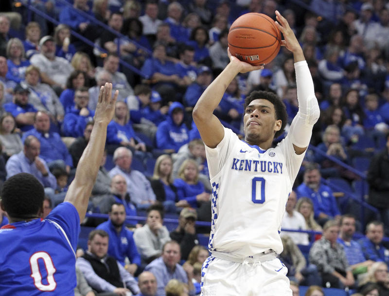 Kentucky's Quade Green, right, shoots while defended by Tennessee State's Armani Chaney during the second half of a 2018 game. (AP)
