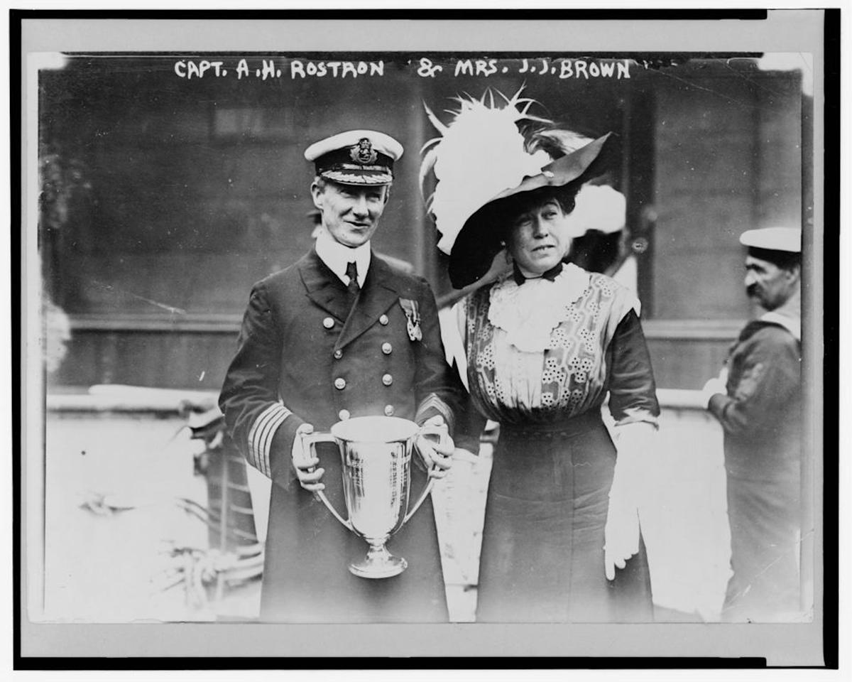 "This May 29, 1912 photograph on display at the Molly Brown Museum shows Mrs. J.J. ""Molly"" Brown presenting a trophy cup award to Capt. Arthur Henry Rostron for his service in the rescue of the passengers on Titanic that sunk April 15, 1912. (AP Photo/Molly Brown Museum)"