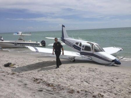 First responders respond at the scene of a single engine Piper Cherokee plane crash in this photo provided by the Sarasota County Sheriff's Office in Caspersen Beach in Venice