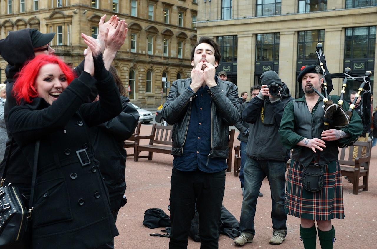 GLASGOW, UNITED KINGDOM - APRIL 08:  Members of the public gather in George Square to mark the death of Baroness Margaret Thatcher on April 8, 2013 in Glasgow, Scotland. It has been confirmed that Lady Thatcher has died this morning following a stroke aged 87. Margaret Thatcher was the first female British Prime Minster and governed the UK from 1979  to 1990. She led the UK through some turbulent years and contentious issues including the Falklands War, the miners' strike and the Poll Tax riots.  (Photo by Jeff J Mitchell/Getty Images)
