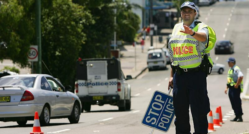 Pictured is a stock image of NSW police officers conducting a RBT check.