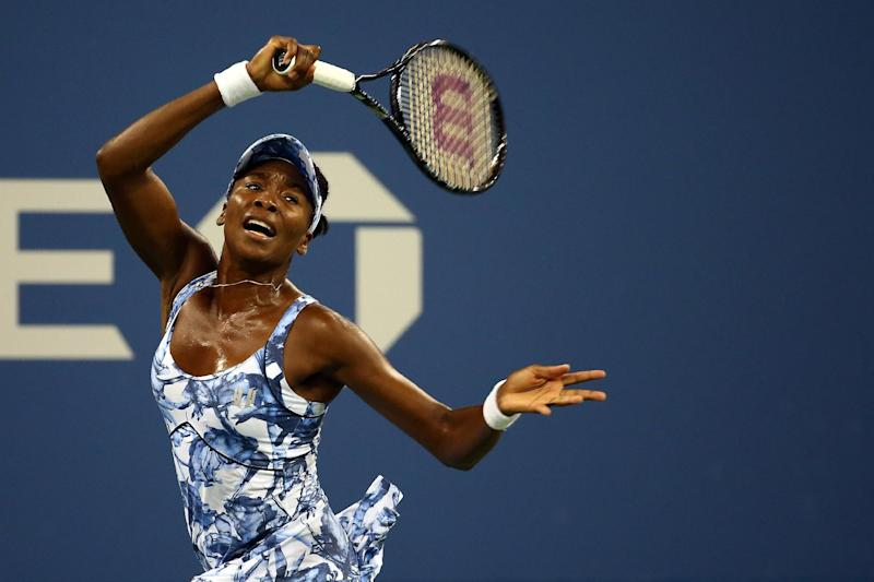 Venus Williams of the US returns a shot to Timea Bacsinszky of Switzerland during their women's singles US Open match, at the USTA Billie Jean King National Tennis Center in New York, on August 27, 2014 (AFP Photo/Streeter Lecka)