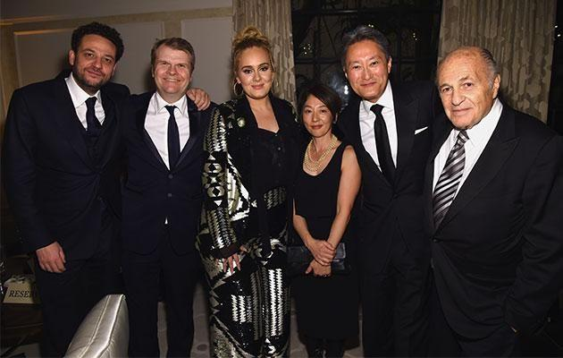 Adele with manager Jonathan Dickins, Sony Entertainment chief Kaz Hurai, Sony Music CEO Doug Morris and Columbia Records chairman Rob Stringer. Photo: Getty Images