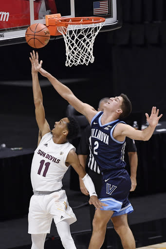 Arizona State's Alonzo Verge Jr., left, shoots as Villanova's Collin Gillespie defends in the first half of an NCAA college basketball game, Thursday, Nov. 26, 2020, in Uncasville, Conn. (AP Photo/Jessica Hill)