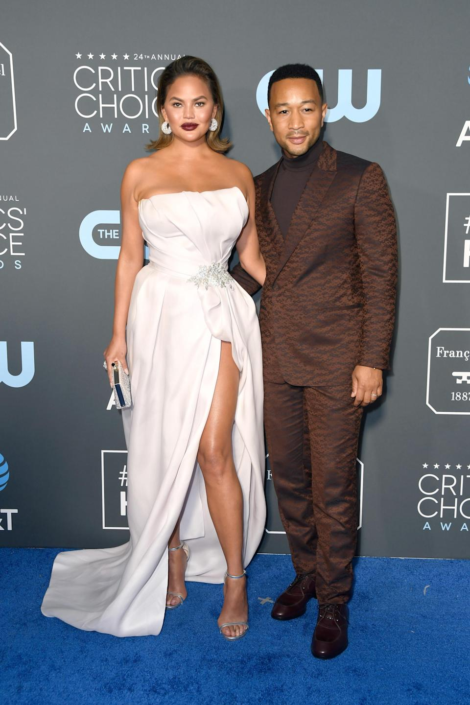 <p>Dress to the nines, Chrissy Teigen and John Legend swooned on the blue carpet. Source: Getty </p>