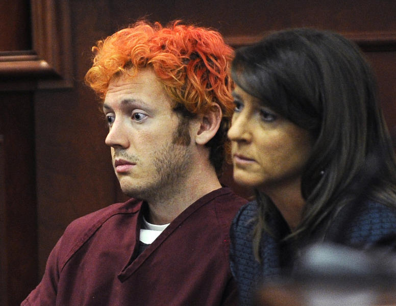 James E. Holmes, left, appears in Arapahoe County District Court, with defense attorney Tamara Brady, right, Monday, July 23, 2012, in Centennial, Colo. Holmes is being held on suspicion of first-degree murder, and could also face additional counts of aggravated assault and weapons violations stemming from a mass shooting on Friday, July 20, in a movie theater in Aurora, Colo., that killed 12 and injured dozens of others. (AP Photo/Denver Post, RJ Sangosti, Pool)