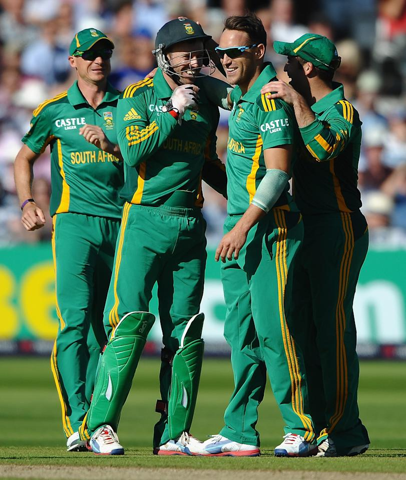 NOTTINGHAM, ENGLAND - SEPTEMBER 05:  Faf du Plessis of South Africa is congratulated by AB de Villiers on the wicket of Alastair Cook of England during the 5th NatWest Series ODI match England and South Africa at Trent Bridge on September 5, 2012 in Nottingham, England.  (Photo by Laurence Griffiths/Getty Images)