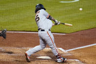 San Francisco Giants' Brandon Crawford hits a solo home run off Pittsburgh Pirates relief pitcher Duane Underwood Jr. during the eighth inning of a baseball game in Pittsburgh, Friday, May 14, 2021.(AP Photo/Gene J. Puskar)