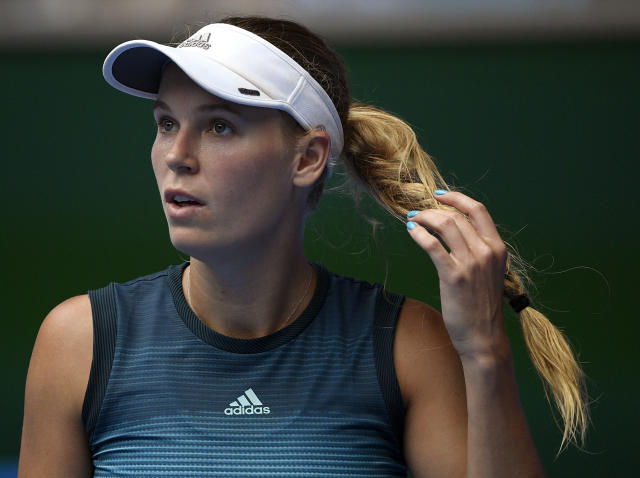 Denmark's Caroline Wozniacki prepares to serve to Sweden's Johanna Larsson during their second round match at the Australian Open tennis championships in Melbourne, Australia, Wednesday, Jan. 16, 2019. (AP Photo/Andy Brownbill)