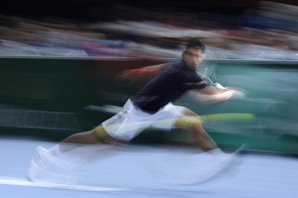 Serbia's Novak Djokovic returns the ball to Britain's Andy Murray during a quarter-final match at the ATP World Tour Masters 1000 indoor tennis tournament on October 31, 2014 in Paris (AFP Photo/Franck Fife)