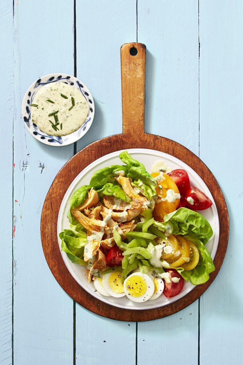 """<p>Step up your lunch game with this chicken wing-inspired salad topped with a homemade buttermilk <a href=""""https://www.goodhousekeeping.com/food-recipes/easy/g27562922/best-vegan-salad-dressings/"""" rel=""""nofollow noopener"""" target=""""_blank"""" data-ylk=""""slk:ranch dressing"""" class=""""link rapid-noclick-resp"""">ranch dressing</a>.</p><p><em><a href=""""https://www.goodhousekeeping.com/food-recipes/a39936/buffalo-chicken-cobb-salad-recipe/"""" rel=""""nofollow noopener"""" target=""""_blank"""" data-ylk=""""slk:Get the recipe for Buffalo Chicken Cobb Salad »"""" class=""""link rapid-noclick-resp"""">Get the recipe for Buffalo Chicken Cobb Salad »</a></em></p>"""
