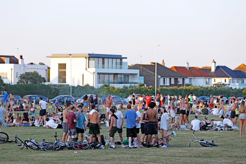 Large groups of people gather down the park at Goring Gap, Worthing, as the UK continues to introduce measures to gradually bring the country out of the coronavirus lockdown.