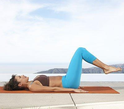 <p>Lie on your back with knees bent to 90-degree angles. Flatten your lower back against a mat and straighten your arms by your sides, lengthening your fingertips. Press the backs of your shoulders against the mat, and slide them down away from your ears. Inhale as you lower your toes toward the ground, then exhale as you return to starting position. Do 5–8 reps.</p>